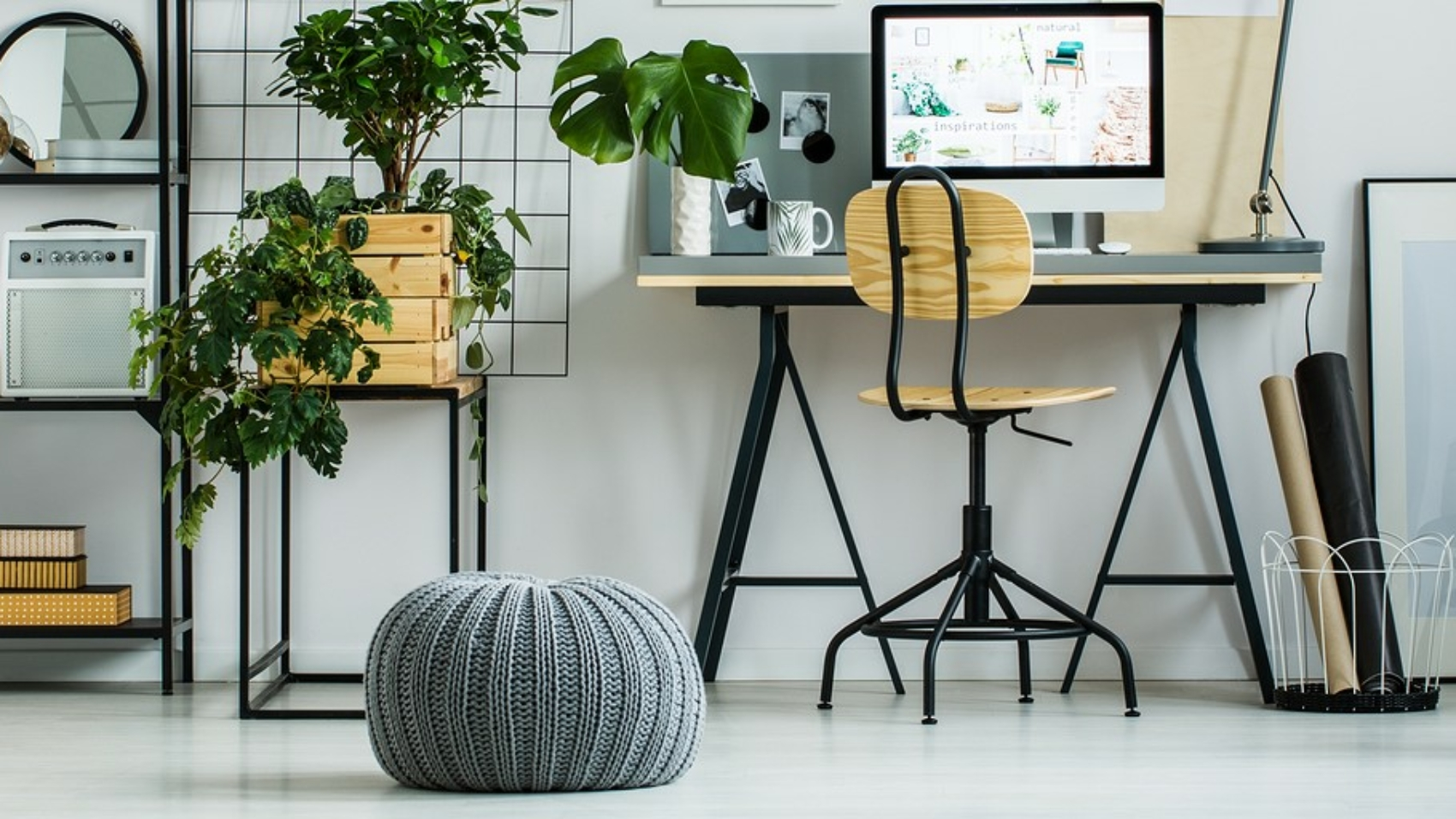 Designed carpet and grey pouf on glossy white floor. Home office design concept